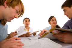 Teenagers studying together Stock Photo