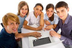 Teenagers studying together Royalty Free Stock Photos