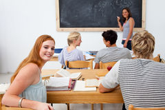 Teenagers studying together in a class Royalty Free Stock Photography