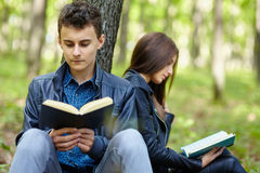 Teenagers studying together outdoor Royalty Free Stock Images