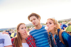 Teenagers at summer music festival blowing buble gums Stock Photography