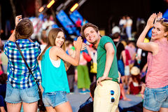 Teenagers at summer music festival clapping and singing Stock Photography