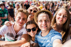 Teenagers at summer music festival in crowd taking selfie Royalty Free Stock Images