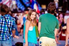 Teenagers at summer music festival having fun Stock Photos