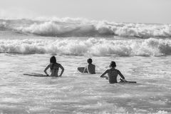 Teenagers Swimming Surfing Waves. Teenagers girls boy swimming surfing morning ocean waves Stock Photo