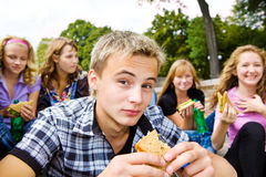Teenagers with take-away food. Teenager group with take-away food Royalty Free Stock Photo