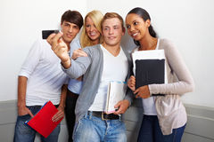 Teenagers taking group photo Stock Images