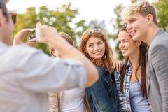 Teenagers taking photo digital camera outside Royalty Free Stock Photos