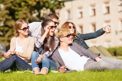 Teenagers taking photo outside with smartphone Royalty Free Stock Image