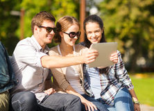 Teenagers taking photo outside Stock Images