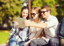 Teenagers taking photo outside Stock Photography
