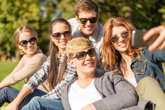 Teenagers taking photo with smartphone outside Royalty Free Stock Photography