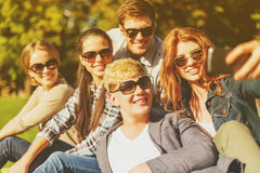 Teenagers taking photo with smartphone outside Royalty Free Stock Image