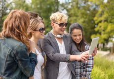Teenagers taking photo with tablet pc outside Stock Photo
