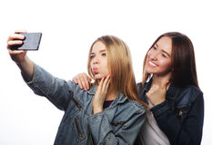 Teenagers taking picture with smartphone Royalty Free Stock Photography