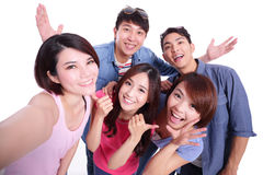 Teenagers taking pictures by themselves Stock Images