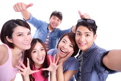 Teenagers taking pictures by themselves Royalty Free Stock Photography