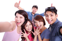 Teenagers taking pictures by themselves stock image