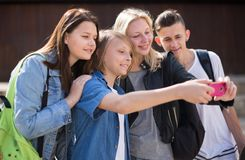 Teenagers taking pictures of themselves on smartphone Stock Photography