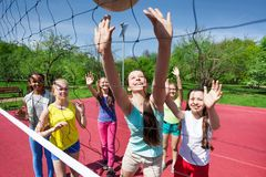 Teenagers team playing volleyball on the court Royalty Free Stock Photos