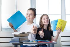 Teenagers teens students are sitting at the table with books st stock images