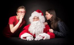 Teenagers tells Santa about their wishes for the christmas presents. New year wishes concept Stock Image
