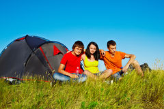 Teenagers beside a tent Royalty Free Stock Images