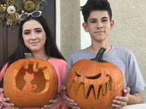 Teenagers with their carved pumpkins at Halloween royalty free stock photos