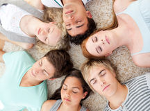Teenagers with their heads together sleeping on th Royalty Free Stock Photo