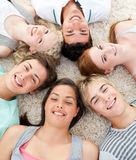 Teenagers with their heads together smiling. High angle of teenagers with their heads together smiling Royalty Free Stock Photography