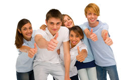Teenagers with thumbs up. On white background Royalty Free Stock Photos