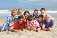 Teenagers together. Smiling on beach Stock Photography