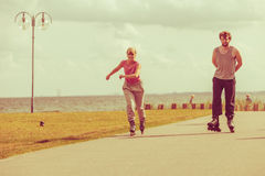 Teenagers together on skates. Stock Images