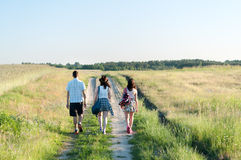 Teenagers Walking Away. Young people walking away along country path Royalty Free Stock Photo