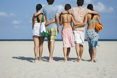 Teenagers Walking On Sandy Beach Royalty Free Stock Photography