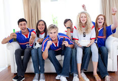 Teenagers watching a football match Stock Photography