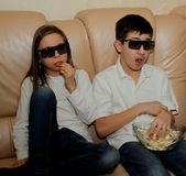 Teenagers watching a movie with interest Royalty Free Stock Images