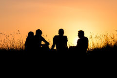 Teenagers watching sunset Royalty Free Stock Photo