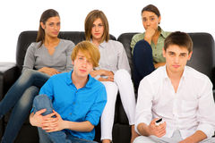 Teenagers watching tv. On a white background Stock Photography