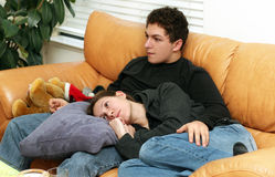 Teenagers watching tv. At home Royalty Free Stock Images