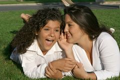 Teenagers whispering. Secrets, friends fun Stock Photo