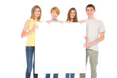 Teenagers with white panel. On white background Stock Photo