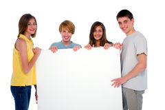 Teenagers with white panel Stock Photos