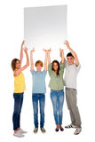 Teenagers with white panel. On white background Royalty Free Stock Photography