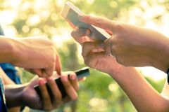Teenagers With Mobile Phone Stock Photography