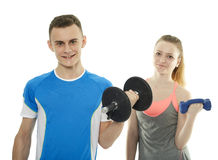 Teenagers working out with dumbbells Stock Photography