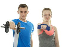 Teenagers working out with dumbbells Royalty Free Stock Photo