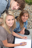 Teenagers working outside Royalty Free Stock Images