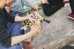 Teenagers Wrapped up in Playing Chess Royalty Free Stock Images