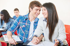 Teenages holding hands in class Stock Photos